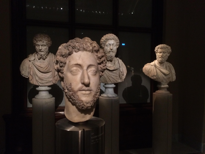 Marcus Aurelius looks askance at his wayward son. Septimus Severus looks bored.