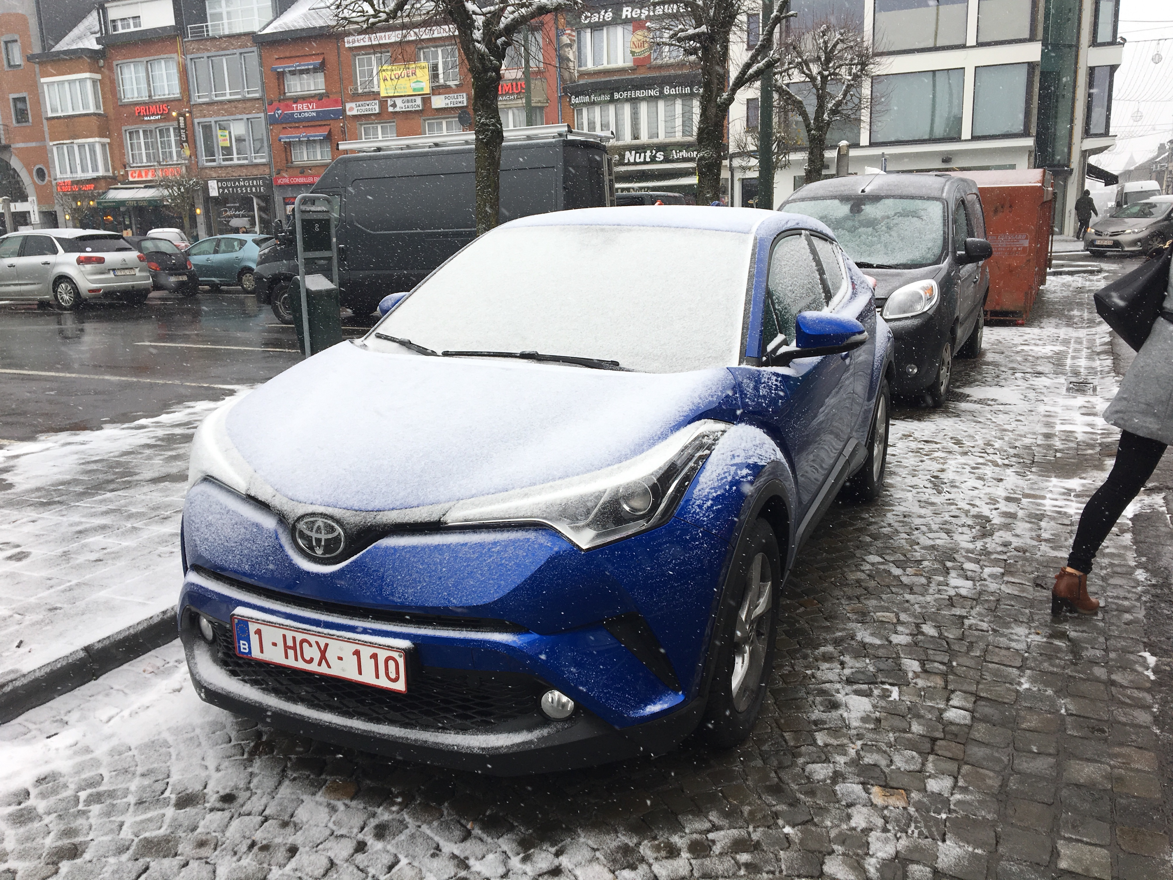 A nice car, covered in snow.