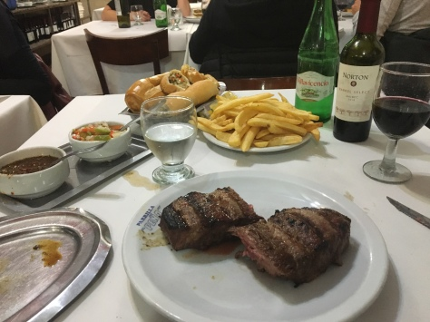 A dinner of steak and chips with Argentinian wine to go with it.