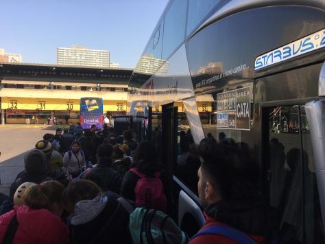 A queue to board a coach in Santiago's Terminal Sur.